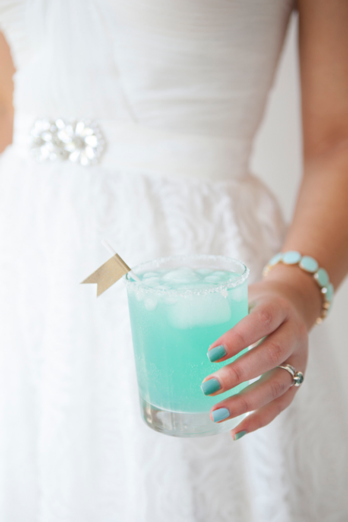 bride holding cocktail glass