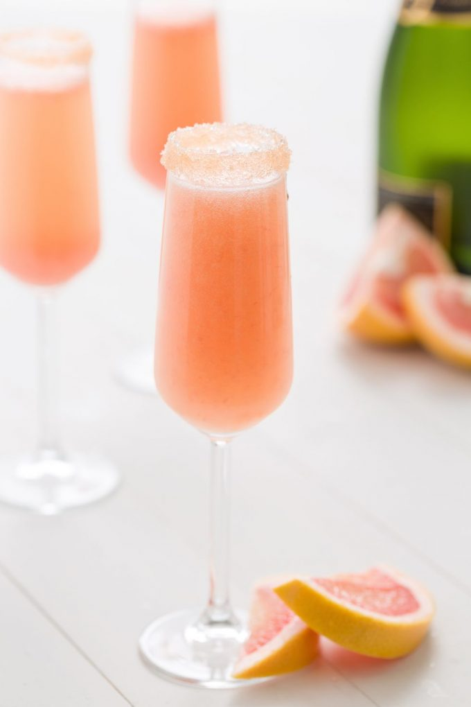 champagne glass wfilled with grapefruit and champagne