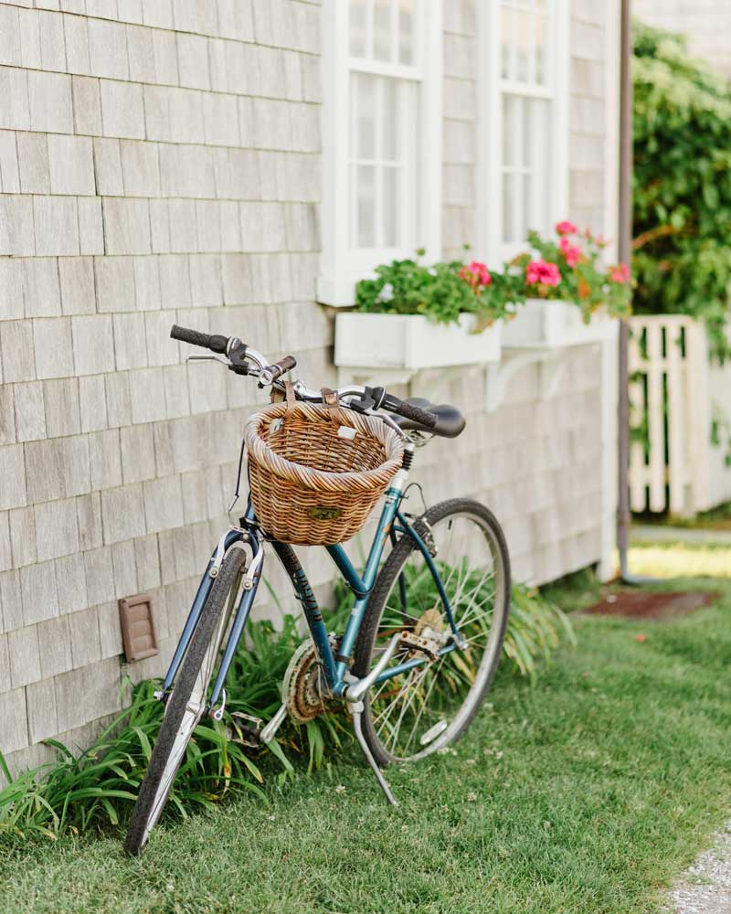bike with basket in front of house